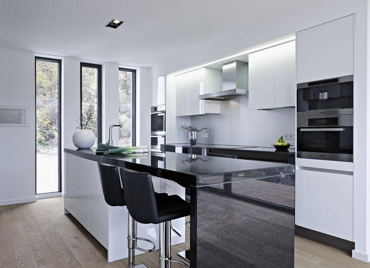Studio4Kitchen created this contemporary classy black and white kitchen using Caesarstone quartz on its countertops.