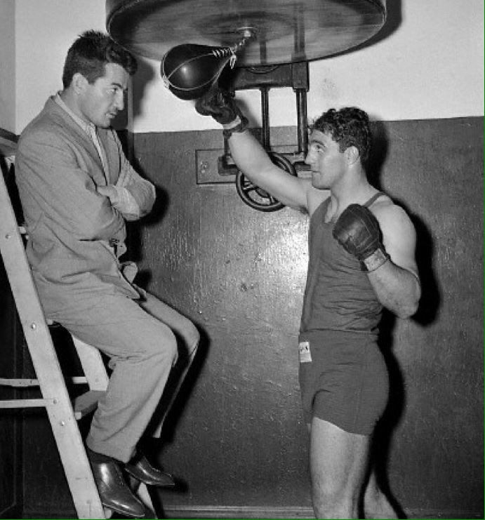 Former middleweight champion Rocky Graziano watching future heavyweight champion Rocky Marciano