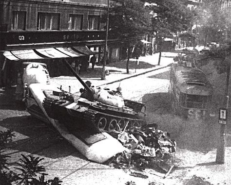 Soviet tank T-55 rams blocked the road tram. Prague 1968.