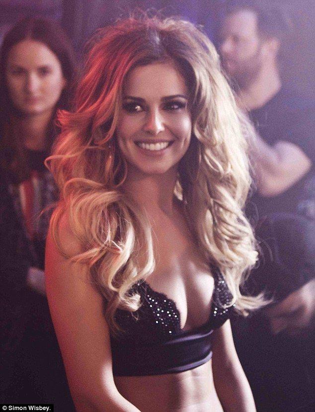 She's still got it: Cheryl looks sensational wearing a beaded crop top for the video