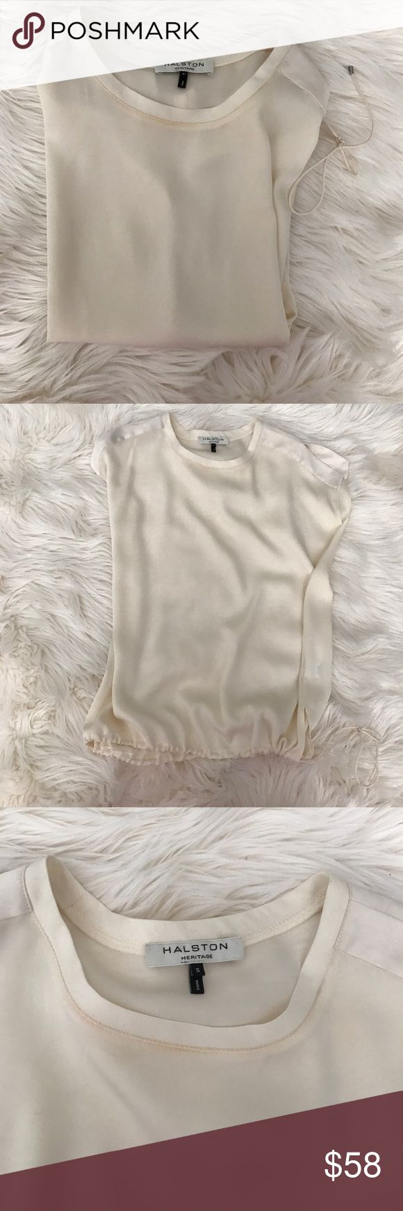 Halston Heritage Silk Blouse Halston Heritage Silk Blouse.  Never worn, gorgeous cream silk with drawstring at bottom.  Has some small stains (shown in photos).  Looks like make up stains from a fitting room.  Possibly removed with dry cleaning.  Otherwise perfect! Halston Heritage Tops Blouses