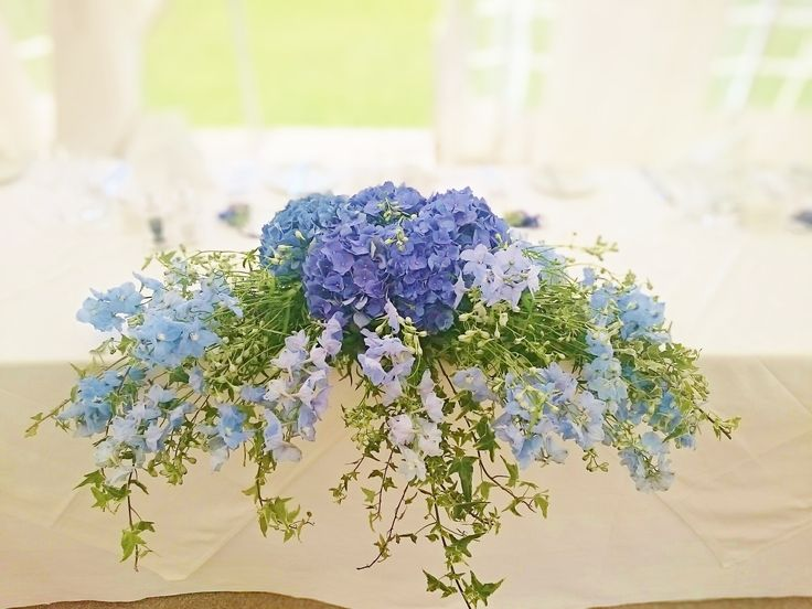 A gorgeous top table centrepiece at one of our recent summer weddings at Prested Hall near Colchester http://www.prested.co.uk/high-season/