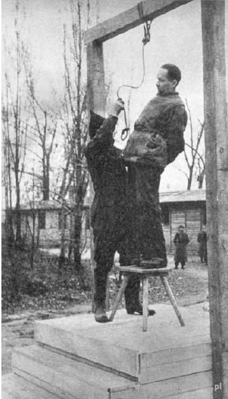 Rudolf Höss, the first commandant of Auschwitz concentration camp, pitifully attempting to avoid the noose at Auschwitz.