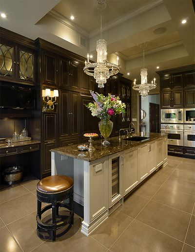 Add some drama to your kitchen with dark cabinets and crown molding. http://www.udecor.com/
