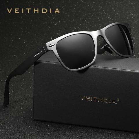 This high quality image of VEITHDIA aluminium men's polarized mirror sun glasses is very black with the sun glasses standing out being shiny is perfect to use on an advertising as its a luxurious brand for men's accessories and it can also be used on a double page spread but as one page with another VEITHDIA brand product.