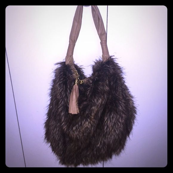 Fur Fashion Bag Amazing statement piece. Luxe fur Melie Bianco hobo bag. Perfect condition - like new. Dual tassel zippers. Polka dot silk inside with zipper compartment. Vegan leather and gold hardware. Melie Bianco Bags Hobos