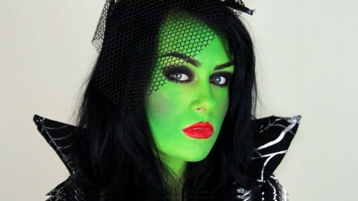 bruja halloween, cara pitada en verde chillón, ojos ahumados, labios en rojo vivo, pelo negro largo