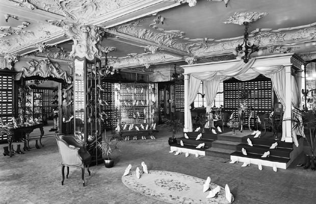 The history of the department store is strangely intertwined with women's path to emancipation. Women's eagerness to shop, one of few public activities considered suitable for females, propelled the department stores to success, and gave women new freedom from the house.This is the luxurious shoe department at Harrods in 1919.