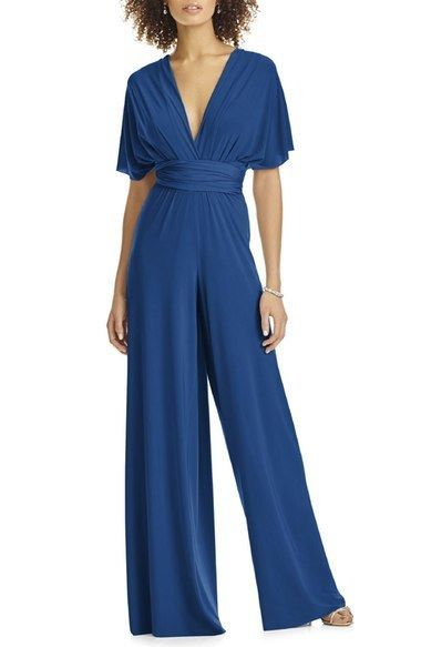 Convertible Wide Leg Jersey Jumpsuit: Jumpsuits work for any type of wedding, from casual to elegant, especially when you choose this Convertible Wide Leg Jersey Jumpsuit, which is available in misses and women's sizes. The pleated surplice bodice has long tails that twist, halter-tie, or wrap over the shoulders in multiple ways, and the open back adds some flirty fun. | Wedding Guest Style: What to Wear to a Wedding When You Don't Want to Wear a Dress http://www.mywedding.com/wed