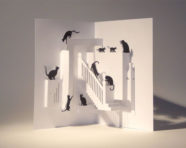 The kittens are just 2D cut outs but when they are placed with a couple centimeteres of space from the walls really contrast as they are black against the white.