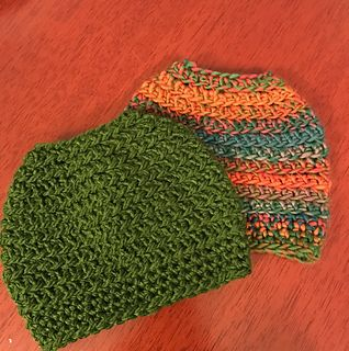 Very simple messy bun hat. This is worked from the top down and in the back loop only. Uses an extended single crochet stitch. You can work this up in an hour. Add a button to the brim or use 2 colors to add stripes.