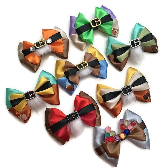 """Heigh Ho! Heigh Ho! Whistle while you work with these bows inspired by Snow White & the Seven Dwarfs. Collect the Seven Dwarfs along with some jewels from their mine train. These bows measure approx. 2.75"""" x 4"""" Perfect for gifts, costumes, your vacation to Disney Parks, Disney bounding, Dapper Day, Disney races, or Disney Cruises. A fun accessory for the Disney fanatic of any age! *Note: This is a handmade item, handle with gentle care. Some parts may be considered a choking hazard. Pl..."""