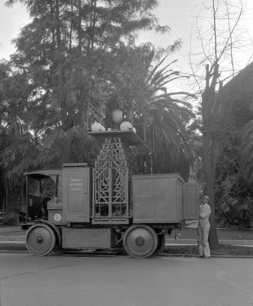 (Early 1920s)* - An electric powered street light truck used by the Bureau of Power and Light in the 1920s.