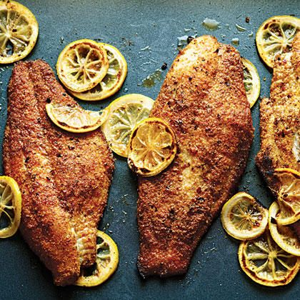 The spicy cornmeal breading on these spicy baked catfish fillets stays crispy when the fish is baked on a ventilated broiler pan. You can also use yellow cornmeal. Try this breading on other white fish fillets.