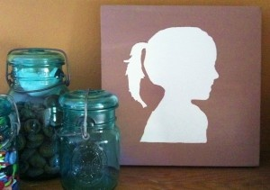your child's silhouette on canvas with acrylic paint
