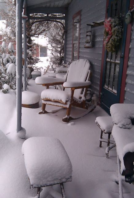 Snow Storm On Front Porch...looks like the cabin we stay in at Leavenworth, Washington