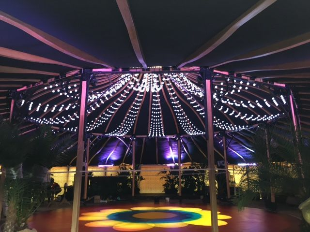 Within our Grand Pavilion with festoon lighting and retro dance floor!