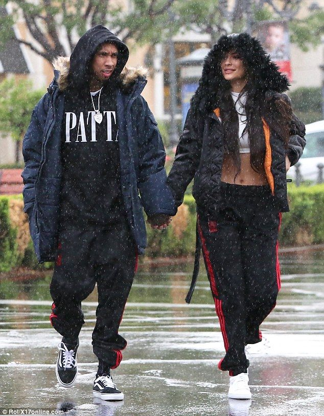 Can't rain on their love parade! Kylie Jenner was spotted hand-in-hand with her beau Tyga, 27, as they headed to the mall in Calabasas on Saturday