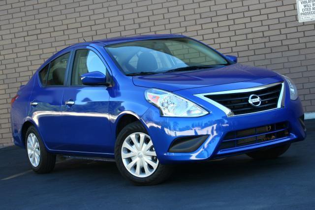 2015 Nissan Versa Sedan review: 2015 Nissan Versa SV -- Chrome grille now standard across the board