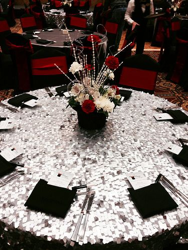 Magic themed event, complete with a top hat floral centerpiece on silver dazzle specialty linens with black linen napkins. | At the Crowne Plaza West in Plymouth, MN