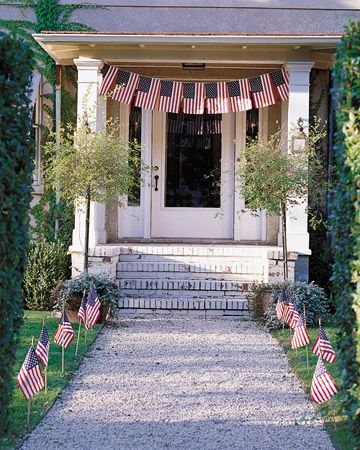 A Festive Swag of Flags Suspend a swag of flags from cotton clothesline over your porch, and then line the walkway with more flags.