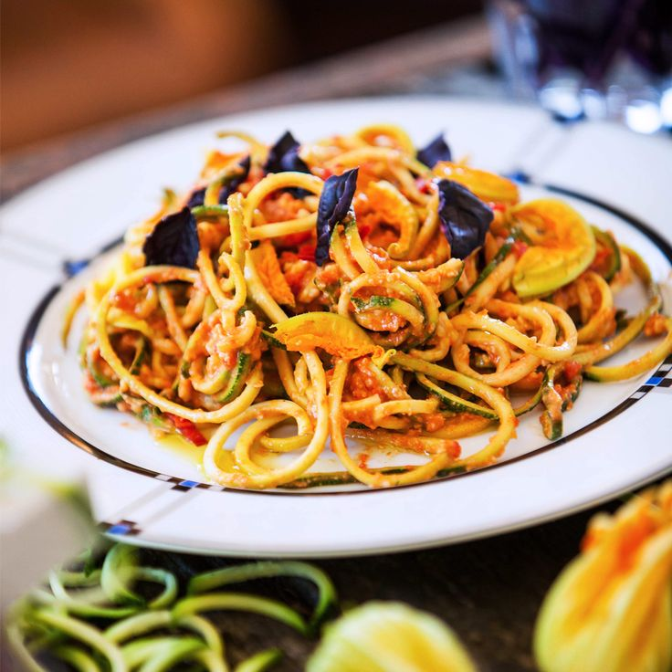 Have you tried our Courgetti with Red Pesto? It's the perfect quick dish for these warmer days when you want something fresh and simple. Colourful vegetable noodles are made in an instant with the Hemsley Spiralizer and our @cuisinart mini processor makes a creamy pesto!