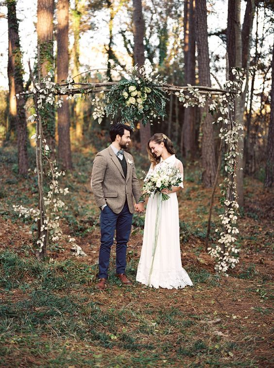 30 Winter Wedding Arches And Altars To Get Inspired: #15. Outdoor woodland boho wedding arch decorated with greenery and blooms
