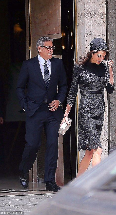 Amal looked as stylish as ever in an Atelier Versace lace outfit as she accompanied her ac...
