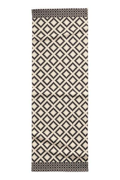 Tapis rectangulaire en coton tissé avec motif imprimé sur le dessus.