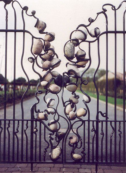 Stonefall Cemetery gates Designed by David F.Wilson, forged by Alan Dawson. - stones in metal