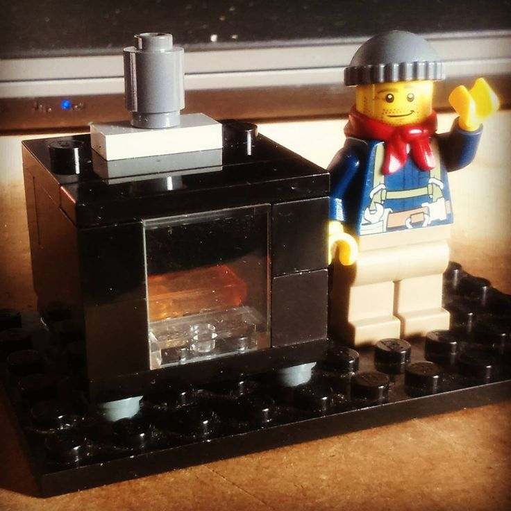 My first Lego picture, featuring one of our heating engineers, Brandon, and my first attempt at a Lego stove.  Brandon goes on to grow a thicker beard, and will always be seen holding something edible (usually a chicken leg!)
