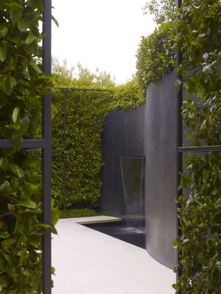We love water features, and we were especially intrigued by this curved black garden fence which includes a sheet waterfall. For water features for your Minneapolis MN landscape, visit us at http://www.aldmn.com