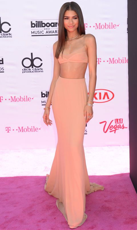 See all the best red carpet fashion arrivals from the 2016 Billboard Music Awards: Zendaya arrives in a coral bra top and high-waisted skirt