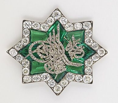One of Queen Victoria's Turkish brooches. In June 1838, soon after her coronation, Queen Victoria received a star-shaped brooch of emeralds and diamonds from Sultan Mahmud II. In the center of the brooch is the Sultan's tughra in brilliant cut diamonds. The tughra is the Sultan's personal calligraphic monogram which was affixed to all official documents, coins, seals, and correspondence. The tughra of Mahmud II reads: 'Mahmud Khan son of Abdülhamid is forever victorious'.
