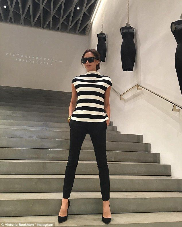 Which one is the mannequin? Victoria Beckham has fun on the steps of her Mayfair boutique in a candid Instagram photo on Monday