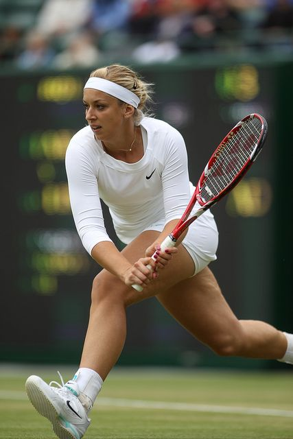 Sabine Lisicki swinging her VCORE TOUR 97 racquet at 2012 Wimbledon