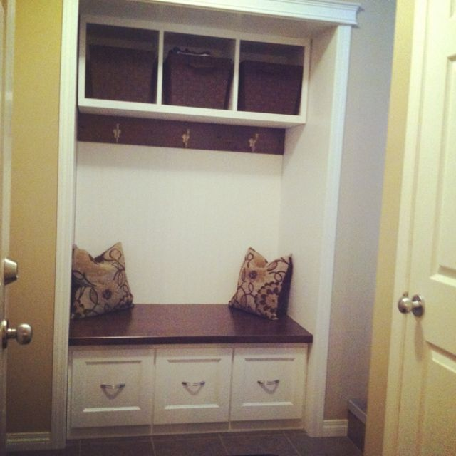 Our back entrance closet converted to a custom bench with hooks.