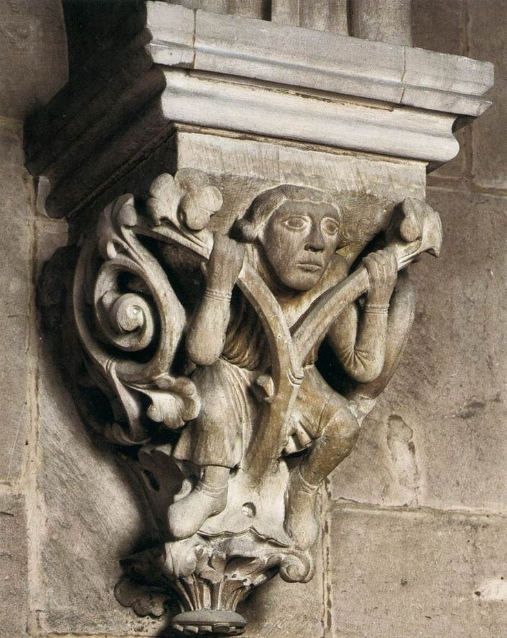 ROMANESQUE SCULPTOR, German, Man in vine foliage, c. 1240, Stone, Protestant parish church, Gelnhausen - Is he wearing ankle height socks?