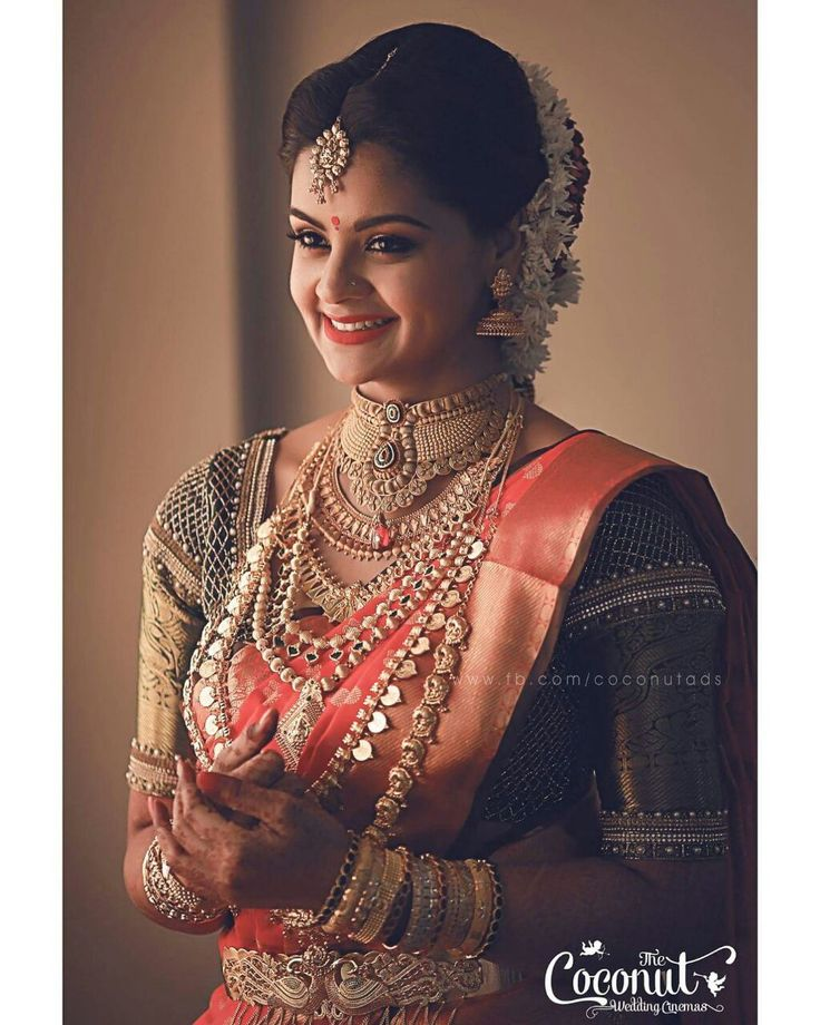 South Indian bride. Gold Indian bridal jewelry.Temple jewelry. Jhumkis.Red silk kanchipuram sari with contrast blouse.Braid with fresh jasmine flowers. Tamil bride. Telugu bride. Kannada bride. Hindu bride. Malayalee bride.Kerala bride.South Indian wedding.