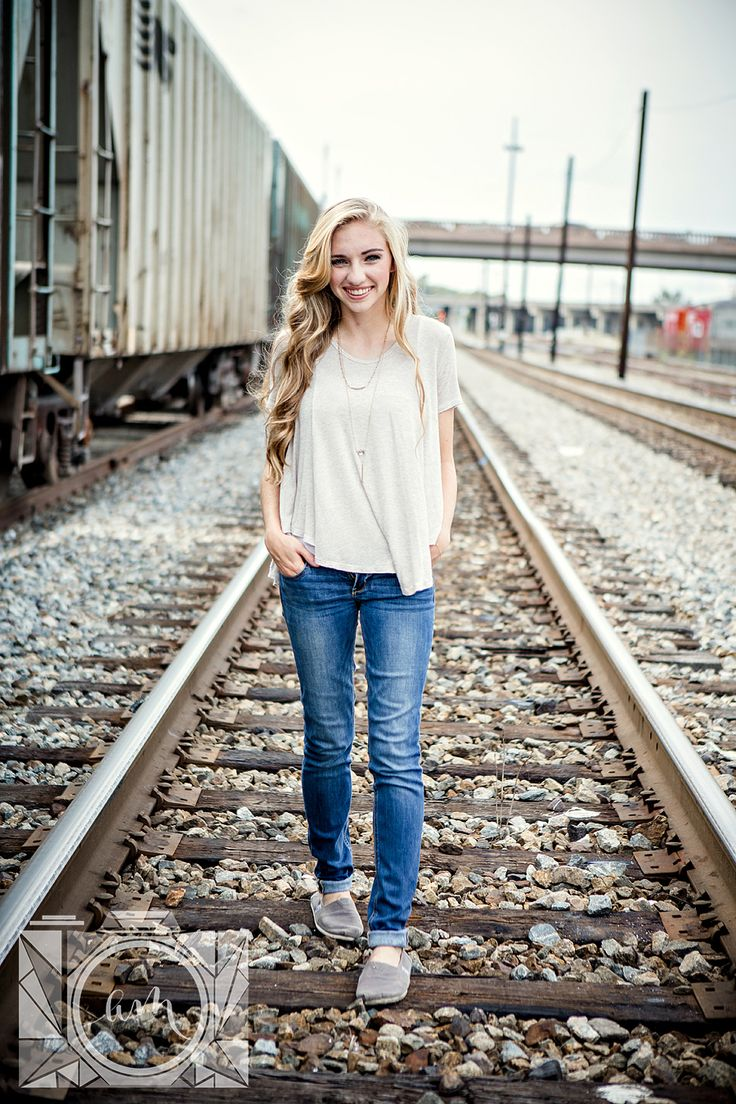 Walking on train tracks senior pictures in downtown knoxville by Amanda May Photos
