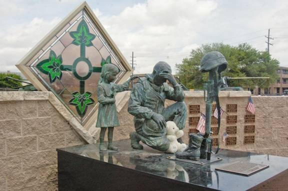 This statue is outside the Iraqi palace, now home to the 4th Infantry Div. It will be shipped tothe memorial museum in Fort Hood TX. Made by Iraqi artist KALAT, who for years was forced by Saddam Hussein to make 100's of bronzes of Saddam. Kalat, so grateful for the America's liberation of his country melted 3 heads of Saddam & made the memorial to the American soldiers & their fallen warriors. L. of the soldier is a small Iraqi girl comforting the soldier mourning his comrades in arms…