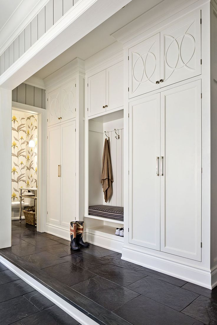 A grand mudroom designed by Worth Interior Design Ltd