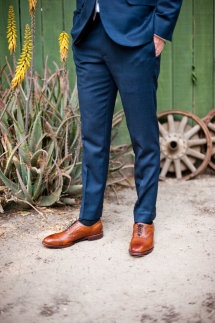 tailored navy suit with brown leather shoes and belt. A must for summer!