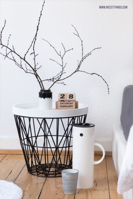 bedside table: ferm living wire basket, house doctor eternity calendar, stelton vacuum jug, normann copenhagen agnes vase