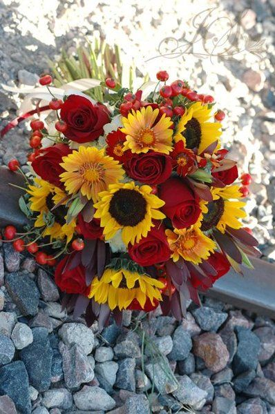 fall bouquet What about red sunflowers and yellow/white roses. . .