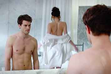 "Christian Grey Strips Down In The New ""Fifty Shades Of Grey"" Trailer"