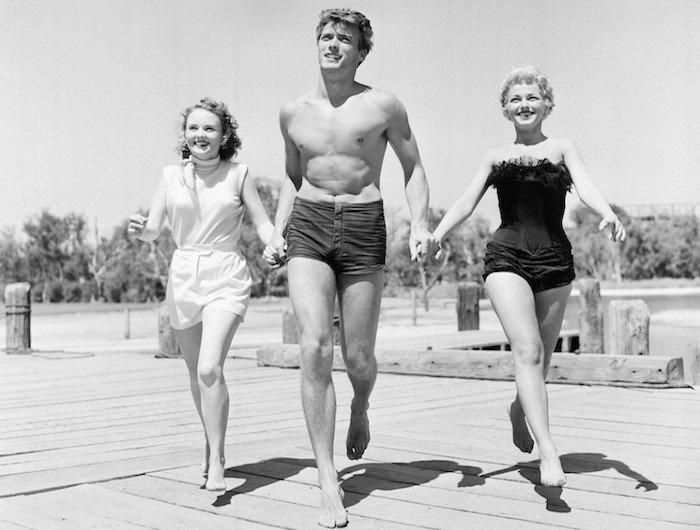 Clint Eastwood with actresses Olive Sturgess and Dani Crayne at a San Francisco beach in 1954.