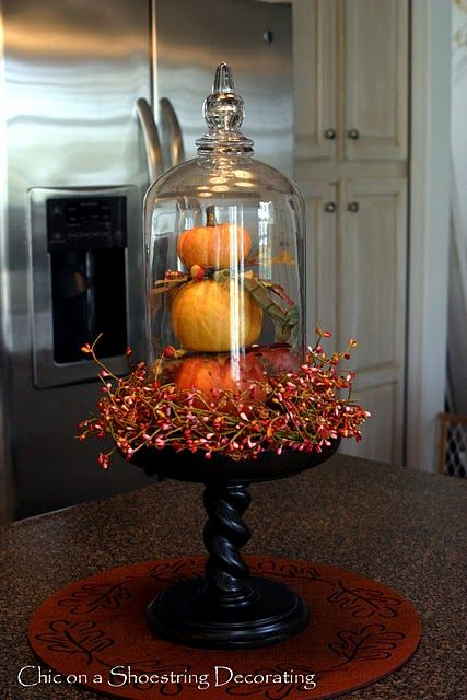 I have a pedestal nearly identical to this and the orange wreath...just need the glass dome for the top.