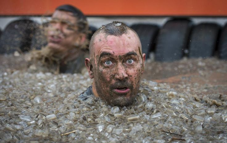 Awesome pic of competitors taking part in #toughmudder Oct. 25, England. #photography Justin Setterfield / Getty