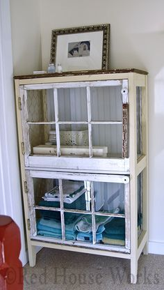 Ruminations (blog) Cabinet constructed of two salvaged windows (the doors), ceramic electric 'knobs' as handles (from knob & tube wiring), salvaged wood for the frame, old barn wood for the top, left over bead board from a bathroom renovation as the back, and chicken wire sides